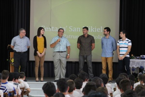 The headmaster presenting the new staff to the students.